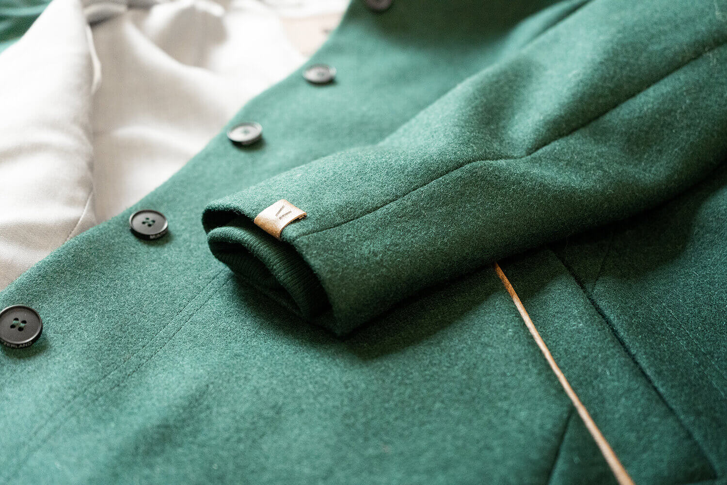 Detail shot of LANA Jacket with buttons – experience LANA without buying our jacket.